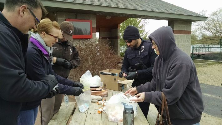 Representatives from the Juneau County Sheriff's Office, Mauston Police Department, Necedah Police Department and S.A.F.E. in Juneau County collect prescription drugs from Jan Suchomel of Necedah.  Pictured left side front to back is Mauston Police Officer Zobal; MacKensie Vinz, S.A.F.E; Scott Jennings, Juneau County Sheriff's Office. Right side front to back, Jan Suchomel and Necedah Police Officer Alex Thompson.
