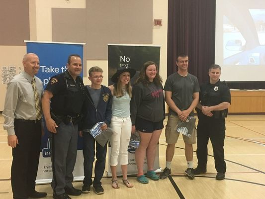 Pictured L-R Principal Scott Uppena, Wisconsin State Patrol Officer Darren Plantz, students Hunter Britzke, Emily Olson, Chelsey Dorow and Matt Preuss and Elroy Officer Shawn Thompson  Photo: Anna Straight