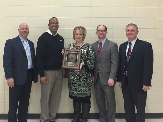 Pictured (L to R): Dave Koller, district manager Midwest Region VALIC Financial Advisors, James Edmond, President of AWSA, Meliss Herek, Principal of Lawrence-Lawson and Cataract Elementary schools, Jim Lynch, executive director, AWSA, Roy Hinz, MEEMIC Foundation.