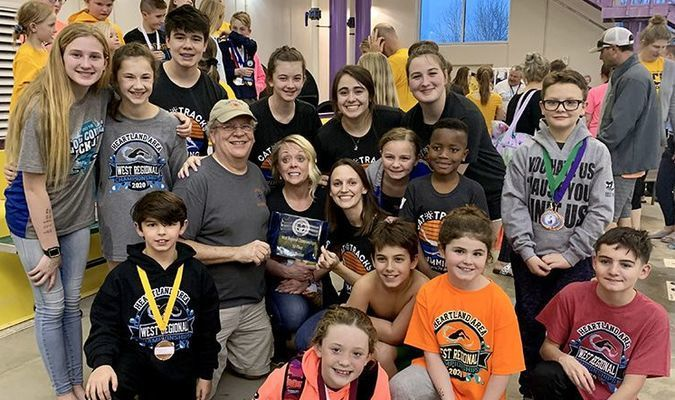 Head Coach Lyman Burr and the CatTracks swim team won their sixth team title at Heartland West Regional Championships during March 13-15 in Monett. The team had first place finishes in 37 individual events and 13 relay events. Six members of the Lamar TigerSharks program competed on the CatTracks Regional Championship Team: Cameron Bailey, 13-14 Boys; Graham Davis, 7-8 Boys; Alix Davis, 11-12 Girls; Kaitlyn Davis, 15-21 Girls; Ryan Davis, 13-14 Boys and Meghan Watson, 15-21 Girls. Cameron claimed victories in three individual events. Graham placed in all of his events and medaled in both of his relays. Alix earned seven medals, along with big cuts in time. Ryan and Kaitlyn each received the High Point Runner-up Trophy for their respective age groups, while Meghan won the High Point Trophy. Cameron and Ryan earned gold medals in all four of their relay events for 13-14 Boys. In the senior Girls division, Kaitlyn and Meghan placed first in all four of their relays, along with new Regional and Pool records in the 400 yard medley relay.