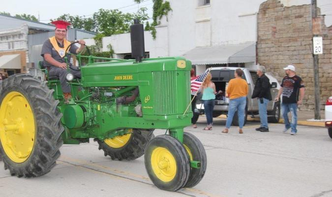 Photo courtesy of Willis Strong Kendall Krueth, a 2020 Liberal High School graduate, drove his tractor in the graduation parade at Liberal on Friday evening, May 15.
