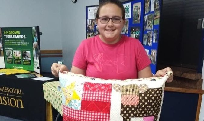 Ashlynn's quilting project is a pillow she created for her room.