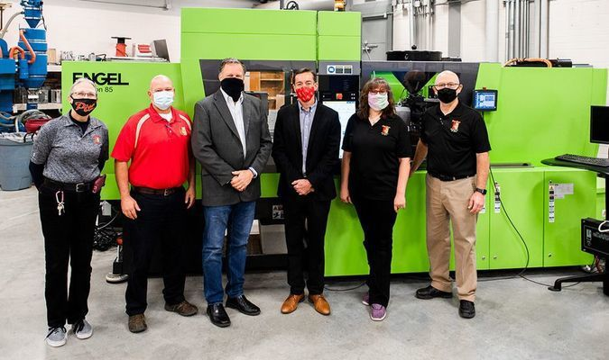 Faculty in the Plastics Engineering Technology program at PSU, along with Greg Murray, chair of Engineering Technology and Blake Benson, president of the Pittsburg Area Chamber of Commerce, gather in one of the plastics labs on Wednesday, Oct. 28, to announce a grant aimed at retraining displaced workers.