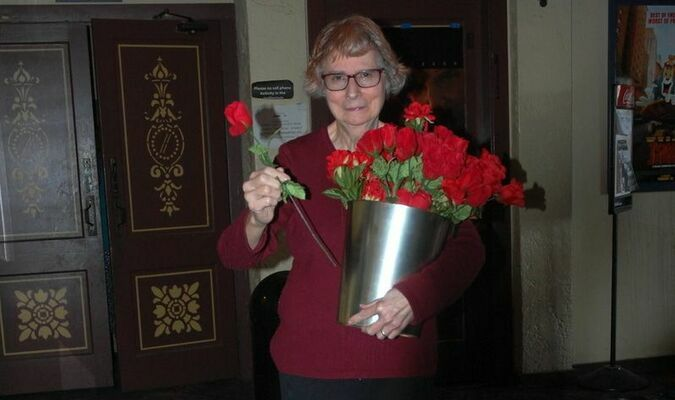 Lamar Democrat/Melody Metzger Rosie Spiering with Barton County Right To Life gave each one attending a red rose as they exited the theatre. A red rose symbolizes the mourning that America experiences at the loss of life to the unborn.