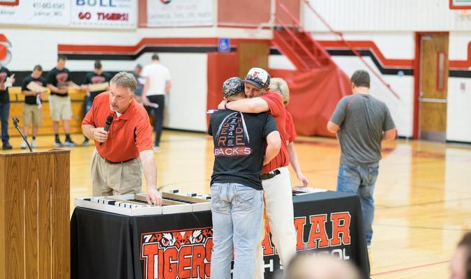 Lamar Democrat/Morgan Brisbin Todd Morrow receives his ring during a celebration held Wednesday evening, April 20, in the Lamar High School gym.