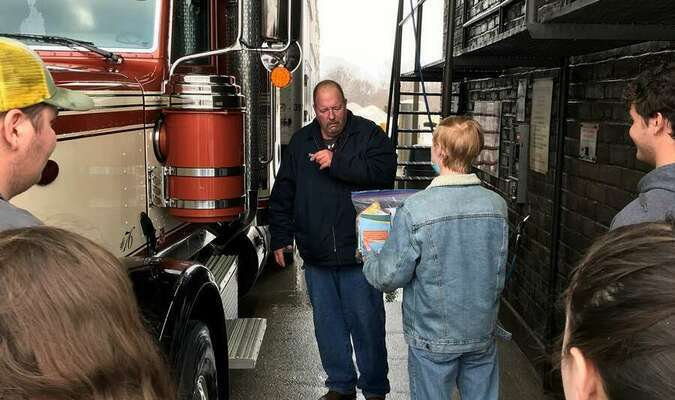 """This livestock hauler was headed to St. Joseph and while he was surprised when Andrew Shelton and the Teen Leaders approached him, he was very appreciative of the """"Trucker's Blessing Bag"""". He stated that this was something new to him, sharing that he had never received anything like this before."""