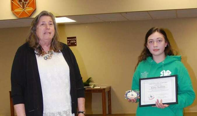 Lamar Democrat/Melody Metzger 4-H member Kitty Sullins was recognized by Elaine Davis at the annual University Extension banquet, as Sullins was a finalist with her entry in the Missouri Bicentennial Commission poster contest.