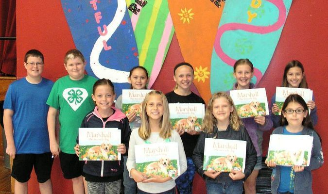 Congratulations are extended to these students selected in the Marshall The Miracle Dog coloring contest and essay contest. Rewards presented were a Marshall the Miracle Dog book signed by Marshall with a paw print and each student received a pass to the Plaza Theatre, including popcorn and drink. Third grade winners were Ashton Coble, Kiley Riggs and Elianna Griffin. Fourth grade winners were Chelsea O'Sullivan, Ella Harris and Alyssa Powell. Fifth grade winners were Cora Pittsenbarger and Sadie Pennell. Not pictured, but selected, was Elise Ferris. Rewards were presented by 4-H Teen Leaders Blaine Shaw and Kyler Cox on April 30, during a school assembly.