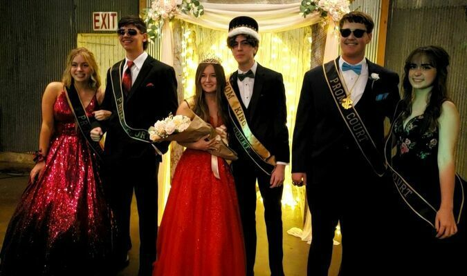 Lamar High School 2021 Prom Queen and King Lexi Phipps and Brayden Tabakian pose along with their court. Pictured are, left to right, Emma Tennal and Gabe Davis, prom court; Phipps and Tabakian, prom royalty and Baylee Wright and Audrey Whitworth, prom court.