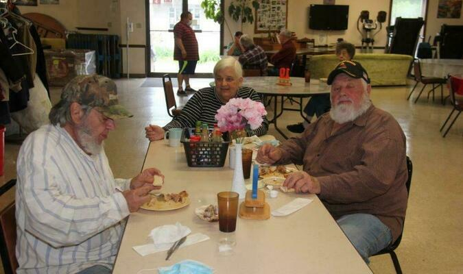 Lamar Democrat/Willis Strong The Barton County Senior Center in Lamar served its first meal in over a year on Tuesday, May 4. The center has been closed due to COVID-19. Shown at the table is Glen and Connie Stump and Joe Stump.