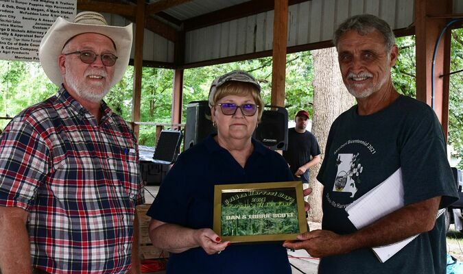Photo courtesy of Sharon Wingert Dan and Lorrie Scott were recognized as Persons of the Year 2021 during Golden Harvest Days. Pictured with the Scotts is Alan Rice.