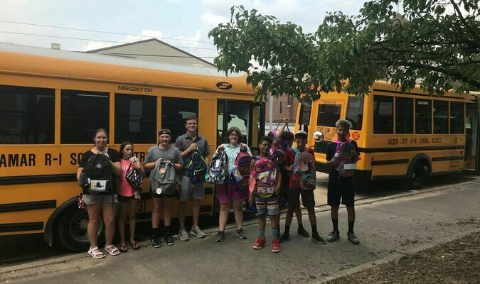 Zane Hull, AOK teen director at Nathan's Place, brought a group of teens that helped accept school backpacks.