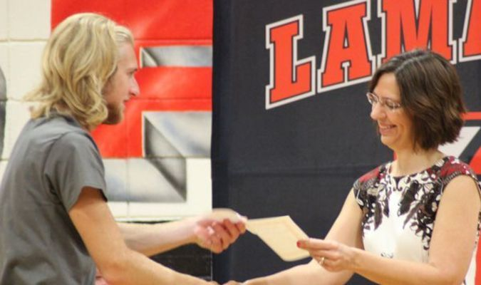 Photo for Lamar Democrat by Anthony Wilkerson The Lamar High School Academic Awards assembly was held Thursday morning, May 12, in the school gymnasium. Peyton Bailey, left, son of Steven and Angela Bailey, was awarded a scholarship by Jill Hall.