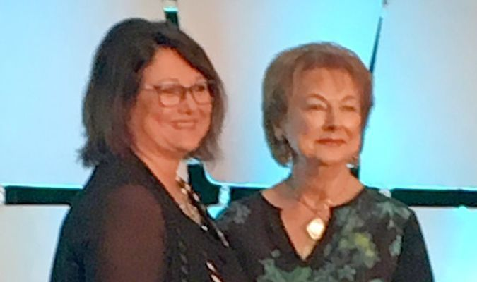 Jane Moyer, left, owner of Decorating Den Interiors in Lamar, received a top design award in her company's international design contest for outstanding design work at the Decorating Den's 47th annual conference held recently in San Antonio, Texas.