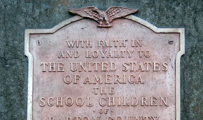 This plaque is placed on the replica of the Statue of Liberty, situated on the southeast corner of the Lamar square.