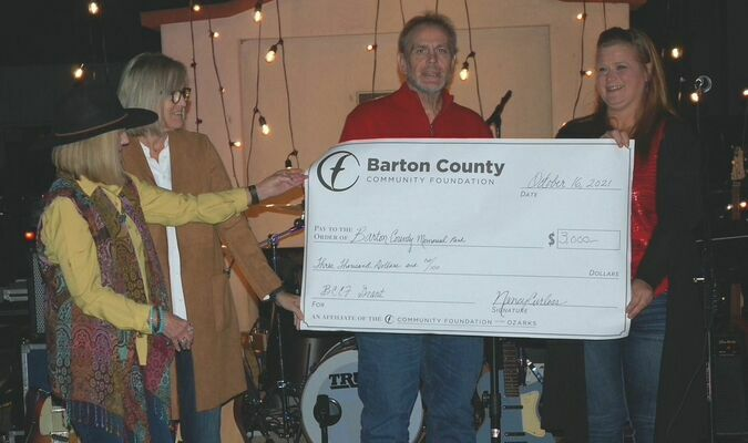 Lamar Democrat/Melody Metzger The Barton County Memorial Park received a grant in the amount of $3,000 from the Barton County Community Foundation. The money received will go towards the purchase of plaques to recognize the organizations that donated money for the six 20 foot flagpoles that will go around the park's war memorial. Pictured are, left to right, Fran Vaughan, Nancy Curless, Joe Davis, who accepted the check and Heidi Johnson.