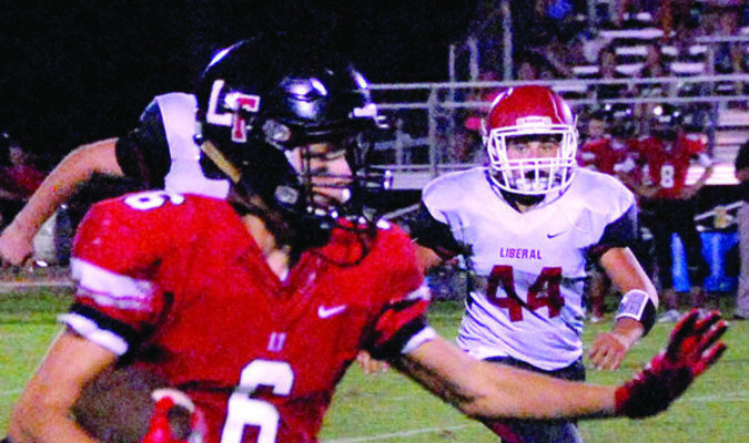 Lamar Democrat/Chris Morrow The Lockwood Tigers knocked off Liberal 50-21 Friday night in the season opener. Here Logan Sparkman looks for running room for Lockwood. Liberal's Weston Sprenkle (#44) gives chase.