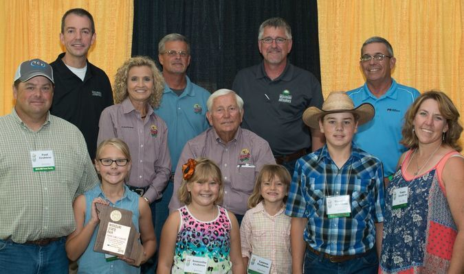 The Crabtrees are pictured, front row, left to right, Paul, Annabelle, Sami Jo, Lauren, Theo and Tanya. State Fair dignitaries pictured in the back row include, left to right, Marshall Stewart, vice chancellor for extension and engagement, MU Extension, Sherry Jones, Missouri State Fair commissioner, Mark Wolfe, Missouri State Fair director, Lowell Mohler, Missouri State Fair commissioner; Richard Fordyce, director of agriculture, Missouri Department of Agriculture and Blake Hurst, president, Missouri Farm Bureau.