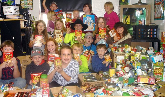 Third graders in Mrs. Harrison's class at Liberal Elementary headed up a canned food drive to be donated to help feed families during the holidays. The elementary donated a total of 1,111 items to the Good Samaritan, to help fill Christmas baskets. Each day students would collect, tally and chart the total for each class. Mrs. Troth's third grade won with 240 cans brought in.