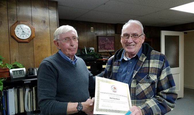 Rick Hornbeck, right, retired from the City of Lamar on January 13, after 28 years of service. He had served as the water plant supervisor. Lamar City Administrator Lynn Calton, left, presented Hornbeck with a certificate in recognition for his years of service.