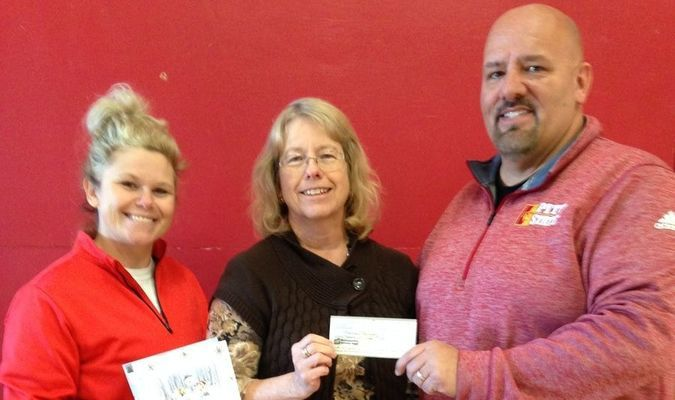 The family of Tim Forst made a donation of $5,000 to aide with the archery program, as it helps area Lamar kids succeed. Pictured are, left to right, Lamar High School Physical Education Teacher Sarah Trout, Diane Forst and West Elementary Physical Education Teacher Harvey Fry.