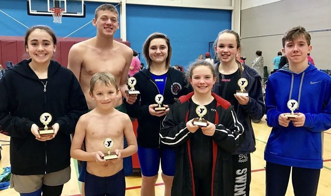 "CatTracks won the Second Place Team Trophy and produced seven individual High Point Trophy winners at the ""Swim Your Heart Out"" Invitational, which was held on February 4, in Lebanon, Mo. Pictured, left to right, row one are William Wright, 8 & Under Boys High Point Runner-up; Sophia Holcomb, 9-10 Girls High Point Runner-up; second row, Kaitlyn Davis, 13-14 Girls High Point Runner-up; Payton Williams, 15-21 Boys High Point Winner; Mycah Reed, 13-14 Girls High Point Winner; Skyler Sundy, 11-12 Girls, High Point Runner-up and Tristan Clanton, 11-12 Boys High Point Winner."