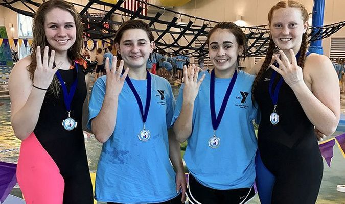 The CatTracks 13-14 girls dominated the relay competition at the 2017 Heartland Regional YMCA Swim Championships during the weekend of March 3-5. The quartet, known as the Fab Four, won the 200 yard freestyle relay, the 400 yard medley relay, the 200 yard medley relay and the 400 yard freestyle relay, while setting Regional records in each event. Pictured, left to right, are Meghan Watson, Mycah Reed, Kaitlyn Davis and Macy Bean.