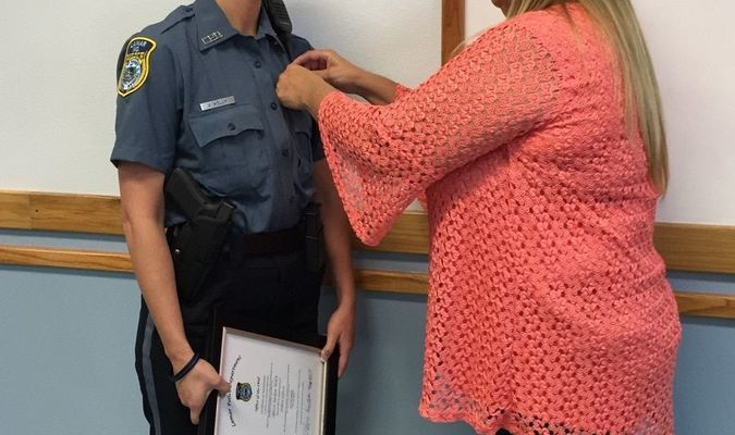 Photo courtesy Diane Helms Jordan Welch was sworn in as a reserve officer, September 18, before the monthly city council meeting. Her mother, Patti Welch, pinned on her badge. Jordan will become the school resource officer.
