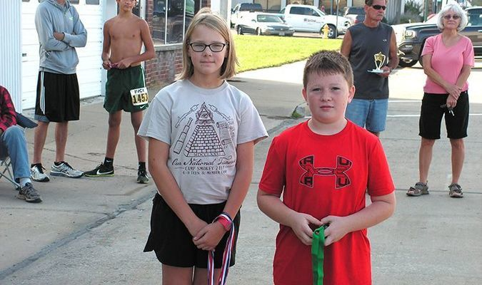 Henry Ball, a member of the Learn A Do 4-H Club, was the one mile medal winner.