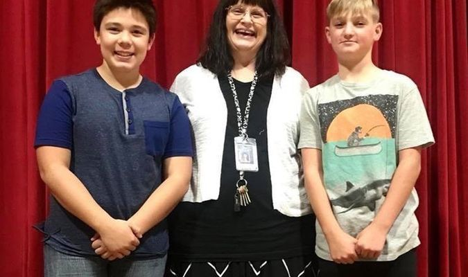 """Pictured with Director Pamela Evitts, middle, is Ryan Davis, who was narrator of """"Little Red and the Hoods"""", left, and Ty Willhite, right, who portrayed the big bad wolf."""