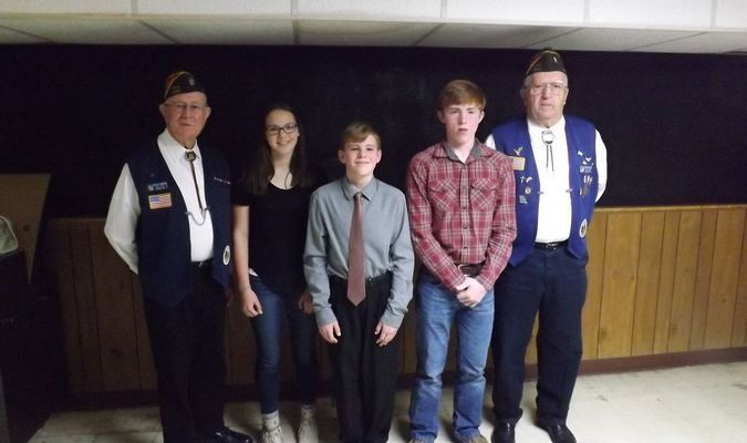 """Patriots Pen essay winners were also honored. Participants are in grades 6-8. Pictured, left to right, Senior Vice Commander Merdith Chapman; first place winner Desirae D. Burr, $50 award; second place Jacob D. Morrison, $40 award; third place Tyler Nance, $30 award; Quartermaster Tom Reed. Patriots Pen participants wrote on the theme """"What Freedom Means to Me."""""""