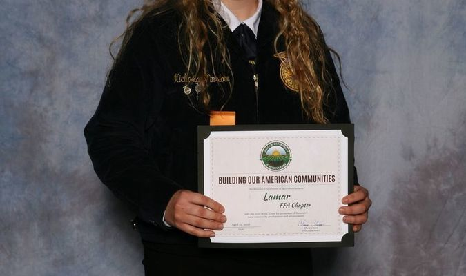 Michaela Winslow of the Lamar FFA Chapter accepts the Building Our American Communities Grant at the 90th Missouri FFA Convention in Columbia, April 19-20. The Missouri Department of Agriculture sponsors the award.