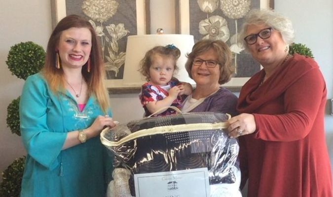 The big winner of the $500 king comforter bed set, given away at the Decorating Den reception held Friday, April 13, was lucky Betty Thieman. Betty is pictured with granddaughter Wacey and Jane Moyer, owner/interior designer, right, and Jen Hurt, interior designer, left. Decorating Den congratulates Thieman and thanks all who attended the reception and day of fun.