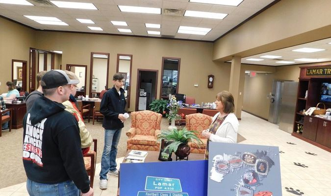 Jill Fast of Lamar Bank and Trust welcomed student in groups as they learned more about LBT, Lamar's hometown bank.