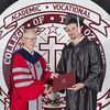 Issac Gariss receives his diploma from College of the Ozarks President Jerry C. Davis.