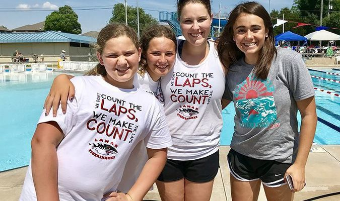 Three members of the Lamar TigerSharks travelled to Siloam Springs, Ark., on June 9. Swimmers could compete in a maximum of three individual events. The top eight finishers in each event scored team points. Kaitlyn Davis won the 15-18 Girls High Point Trophy with first place finishes in the 200 yard freestyle, 200 yard IM and 100 yard freestyle. Addison Zamora finished in second place overall for 9-10 Girls. Zamora took first place in the 100 yard freestyle, second place in the 50 yard freestyle and second place in the 100 yard IM. Nevaeh Jones finished eighth in both the 50 yard backstroke and 50 yard butterfly. Pictured, left to right, are Addison Zamora, Nevaeh Jones, Head Coach Jessica Zamora and Kaitlyn Davis.
