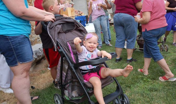 Lamar Democrat/Melody Metzger Laken Todd, daughter of Lindsay and Laramie Todd, enjoyed Madness on Main Street Thursday evening, in Golden City. Between the perfect weather and ice cream there was much to be happy about.