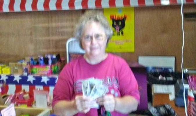 Mrs. Wayne Keatts received a cash prize of $250 at Big Charlie's Fireworks on the afternoon of July 4. Her husband, Wayne Keatts Locksmith Service in Lockwood, was the lucky name drawn from the large box of entries. Congratulations again to Wayne and thank you for shopping at Big Charlie's Fireworks on the outer road north in Lamar.