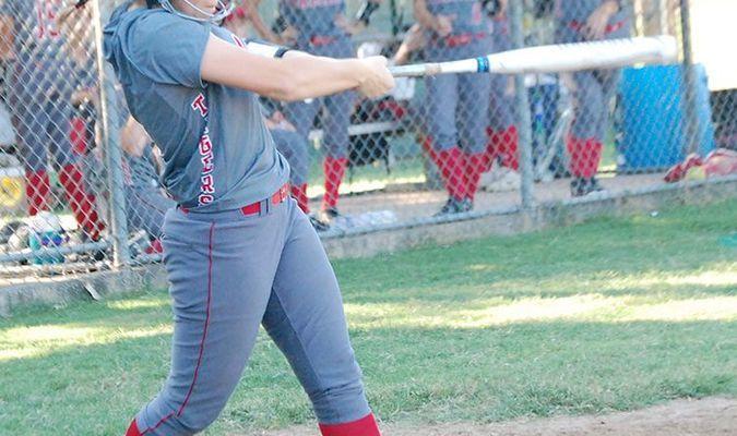 Lamar Democrat/Chris Morrow Lamar's Ashley Lawrence puts a good swing on a ball during a home contest last week.