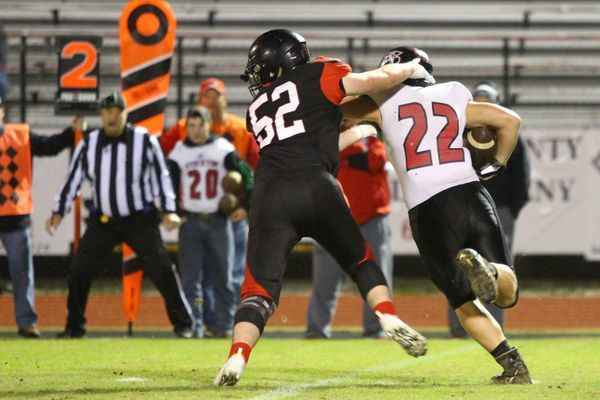 Photo by Terry Redman Lamar senior defensive end No. 52 Carter Young drops this Stockton ball carrier for a loss in Lamar's 63-6 district first round victory.