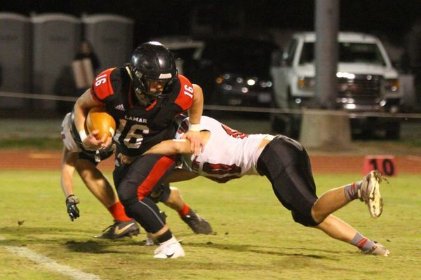 Photo by Terry Redman Lamar sophomore quarterback No. 16 Case Tucker fights for extra yardage after a long run for the Tigers. The Tigers destroyed Stockton 63-6 to advance to the second round of districts.