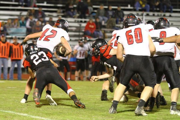 Photo by Terry Redman No. 23 sophomore Johnathan Contrares and No. 62 freshman Robert Lawrence team up to bring down this Stockton running back. The JV and freshman team played the majority of the game as Lamar ended Stockton's year with a 63-6 thrashing.
