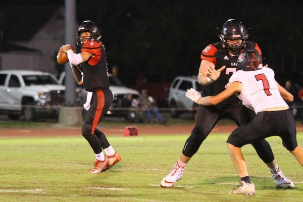 Photo by Terry Redman Lamar junior offensive tackle No. 72 Connor O'Neal pass blocks for senior quarterback No. 6 Duncan Gepner in Lamar's first round district victory over Stockton.