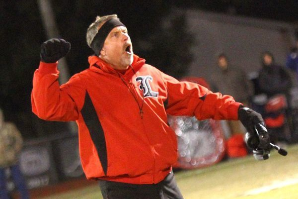 """Photo courtesy of Terry Redman Lamar football coach Scott Bailey tries to pump up the crowd as he throws his fist into the air and yells, """"4th quarter""""… """"4th quarter""""… """"4th quarter""""..."""