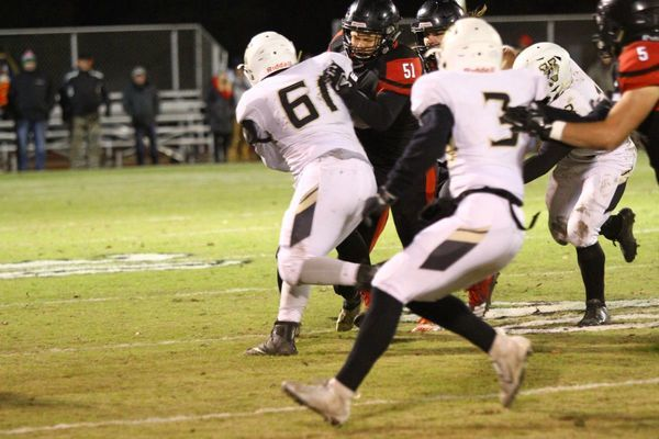 Photo courtesy of Terry Redman No. 51 senior lineman Alex Burgess blocks for Trevor Medlin in football action at Thomas M. O'Sullivan Stadium. The Tigers defeated the Versailles Tigers to win their 11th straight district championship.