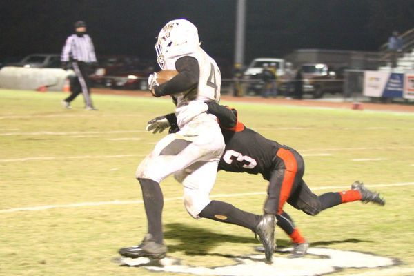 Photo courtesy of Terry Redman The junior varsity saw considerable action in Lamar's 51-28 victory over Versailles. Here, No. 3 sophomore Cade Griffith, makes the tackle on this running back.