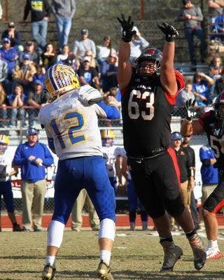 No. 63 junior defensive tackle Juan Juarez pressures the Ava quarterback in action at Thomas M. O'Sullivan Stadium. The Tigers defeated the Ava Bears to advance to the semifinals for the 10th straight year.