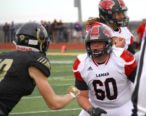 Lamar senior lineman No. 60 CJ Maldonado blocks as No. 6 Senior quarterback Duncan Gepner scores the first of three touchdowns to take an early 7-0 lead. The Tigers streak of seven straight state championships was ended by the Mules by a score of 28-21.