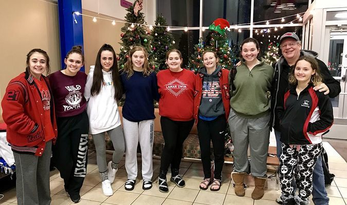 The Lamar High School girls swim team travelled to Monett for a swim meet on December 4. The Lady Tigers placed fifth overall against 12 other teams, including area schools such as Carl Junction, Carthage, Joplin, Lebanon, Monett, Nevada, Thomas Jefferson and Webb City. Pictured, left to right, are Kaitlyn Davis, Meghan Watson, Team Manager Audrey Whitworth, Emma Tennal, Cher McCall, Abby Kluhsman, Sam Capehart, Coach Lyman Burr and Nevaeh Jones.