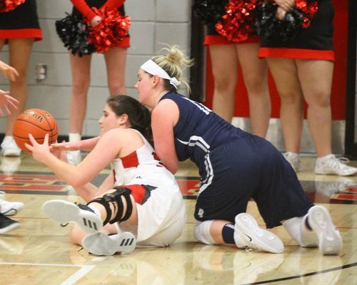Lamar junior No. 32 Halle Miller gets down on the floor to retrieve a loose ball in girls action at Lamar High School. The Lady Tigers defeated Galena 50-32.